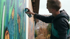 Graffiti artist drawing on the wall, slow motion - stock footage