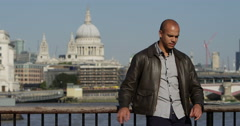 An attractive man waiting for someone with St. Paul's Cathedral in background. Stock Footage