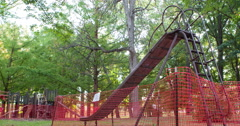 Slide at playground with fence around it quarantined off 4k Stock Footage