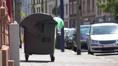 Trash can dumpster on side of city street in Europe 4k Stock Footage