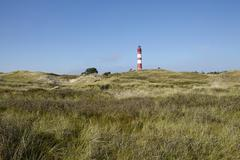 Amrum (Germany) - Lighthouse in the sand dunes - stock photo