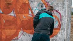 Graffiti artist drawing on the wall Stock Footage