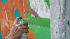Graffiti artist drawing on the wall, close up - stock footage