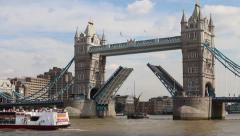 Tall ship passes through the open drawbridge of Tower bridge  - stock footage