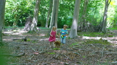 4K Happy little boy & girl walking with pet puppy in the woods Stock Footage