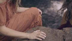 Woman Brushes Her Hand Over Rock, Enjoys Nature With All Of Her Senses Stock Footage
