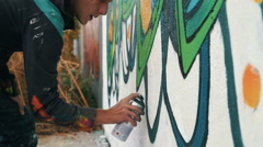 Graffiti artist drawing on the wall, close up, slow motion Stock Footage