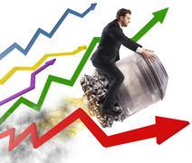 Businessman between stats Stock Photos