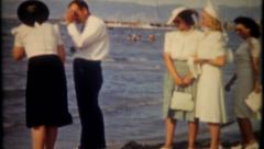 2643 - fashionable tourist visit beach resort - vintage film home movie - stock footage