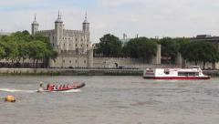 Tourist boats float past the Tower of London on the Thames Stock Footage
