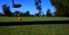 Orange golf ballmhit - stock footage