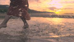 Young Women Splash/Dance In Water At Sunset, One Splashes Camera Lens Stock Footage