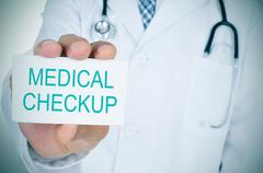 Doctor showing a signboard with the text medical checkup Stock Photos
