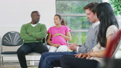 4K Happy couple expecting a baby wait to see the doctor  - stock footage