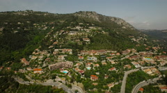 Eze Aerial over and up Eze mountainside - stock footage