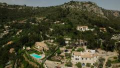 Eze Aerial over and up Eze mountainside Stock Footage