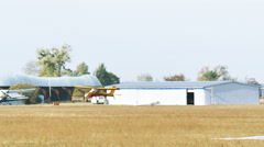 Scene from life of small airfield with  gliders, people and plane.  Stock Footage