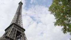 Champ de Mars Tour Eiffel in Paris by the day 4K 2160p 30 fps UltraHD slow pa Stock Footage
