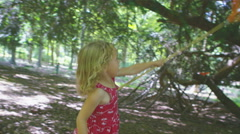 4K Portrait of happy little girl playing in the woods with fishing net - stock footage
