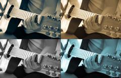 Woman playing acoustic guitar Stock Photos
