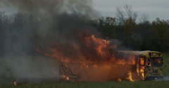 Exploding School Bus - Fiery automobile - flames and smoke Stock Footage