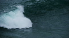 CU slow motion of wave breaking, Cornwall, UK Stock Footage