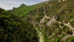 France Countryside Aerial through canyon over river in Rougon area panning right Stock Footage