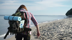 Man hiker with backpack tramping by seaside 4K Stock Footage