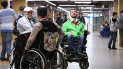 People with disabilities in the hallway of a public building. Stock Footage