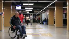 Man with disabilities in the hallway of a public building. Stock Footage