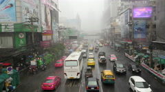 Stock Video Footage of Traffic in Downtown Bangkok During Rainstorm