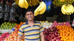 Stock Video Footage of Fruit Vender Waves Hello - Kuala Lumpur Malaysia