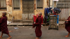 Novice Children Monks walk past Building - Myanmar Burma - stock footage