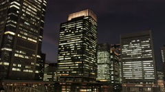 Hi Rise Office Buildings around Tokyo Station at Night Stock Footage