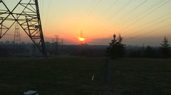 Fireball red sunset with hydro transmission towers and powerlines Stock Footage