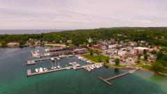 Harbor Springs Aerial low backwards panning left over harbor Stock Footage