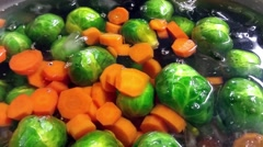 Boiling bruce sprouts and carrots, and then cooling them down, at a restauran Stock Footage