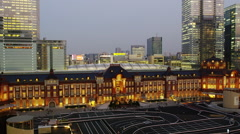 Elevated View of Tokyo Station with High-Rise Buildings early Evening - stock footage