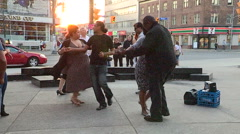People in Toronto salsa and tango dancing in the street at sunset Stock Footage