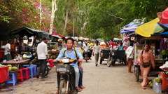 Stock Video Footage of Traffic on Local Street - Siem Reap Cambodia