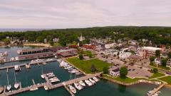 Harbor Springs Aerial low backwards over downtown and harbor - stock footage