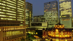 Elevated View of Tokyo Station with High-Rise Buildings early Evening Stock Footage