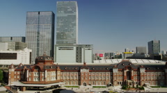 Day View of Tokyo Station with Office Buildings surrounding it Stock Footage