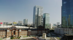 Day View of Tokyo Station with Office Buildings surrounding it - stock footage