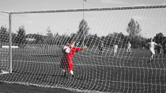 A soccer player makes a penalty kick into the goal - stock footage