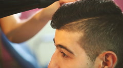 Barber working with hair dryer Stock Footage