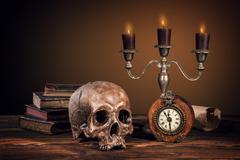 Still life art photography on human skull skeleton - stock photo