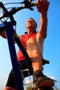 Mountain Bike cyclist riding single track at sunrise Stock Photos