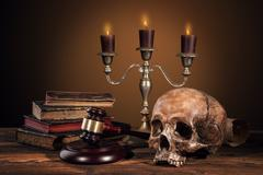 Still life art photography on human skull skeleton - stock photo