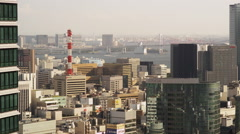 View of Hi Rise Buildings of Central Tokyo and Rainbow Bridge - stock footage